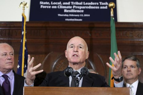 California Gov. Jerry Brown (C) speaks during a media briefing by members of President Barack Obama's Climate Task Force committee in Los An