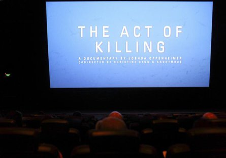 "People watch ""The Act of Killing"" movie in Jakarta, February 6, 2013. REUTERS/Beawiharta"