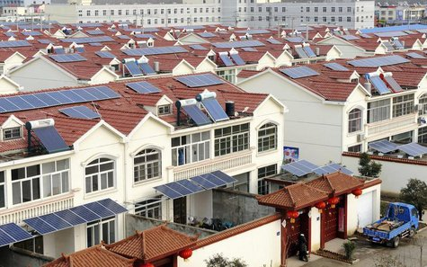 Solar panels are seen on the roofs of residential houses in Qingnan village of Lianyungang, Jiangsu province January 8, 2014. REUTERS/String