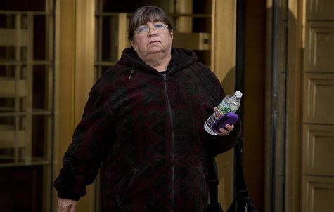 Bernie Madoff's former secretary, Annette Bongiorno departs Manhattan Federal Court in the Manhattan Borough of New York February 24, 2014.
