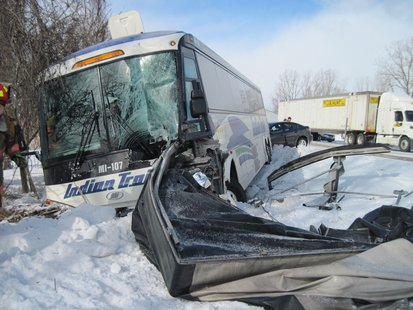 The bus driver and 8 passengers received treatment following the crash.