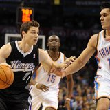 Jan 19, 2014; Oklahoma City, OK, USA; Sacramento Kings point guard Jimmer Fredette (7) dribbles the ball as Oklahoma City Thunder center Ste
