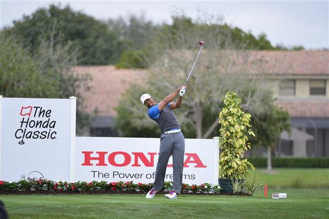 Feb 27, 2014; Palm Beach Gardens, FL, USA; Tiger Woods on the 12th tee at PGA National GC Champion Course. Mandatory Credit: Bob Donnan-USA
