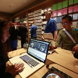Customers test out Apple products inside Berlin's first Apple store during its grand opening May 3, 2013. REUTERS/Pawel Kopczynski