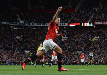 Manchester United's Robin Van Persie celebrates scoring against Stoke City during their English Premier League soccer match at Old Trafford