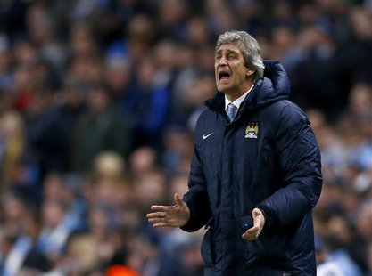 Manchester City's manager Manuel Pellegrini reacts during their Champions League round of 16 first leg soccer match against Barcelona at the