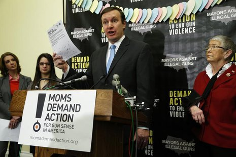 U.S. Senator Chris Murphy (D-CT) (C) speaks at a news conference held by the groups Mayors Against Illegal Guns and Moms Demand Action for G