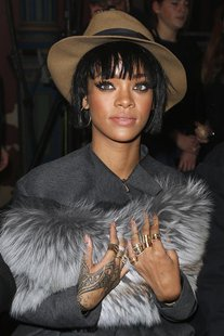 Singer Rihanna poses before the Lanvin Fall/Winter 2014-2015 women's ready-to-wear collection show during Paris Fashion Week February 27, 20