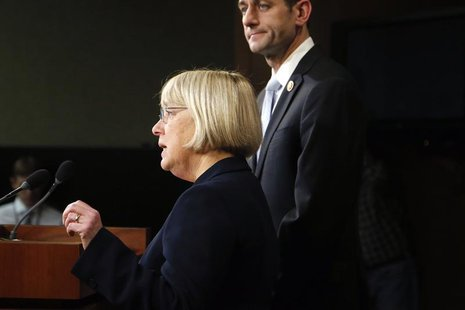 Senate Budget Committee chairman Senator Patty Murray (D-WA) (L) and House Budget Committee chairman Representative Paul Ryan (R-WI) hold a