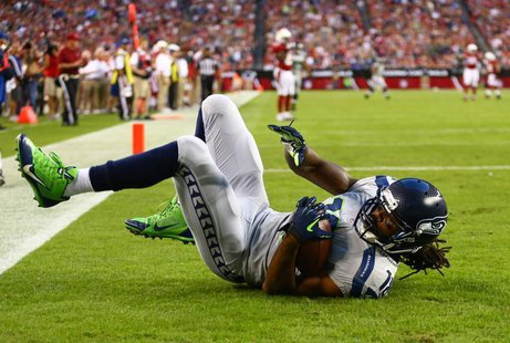 Oct 17, 2013; Phoenix, AZ, USA; Seattle Seahawks wide receiver Sidney Rice (18) catches a touchdown pass in the first quarter against the Ar