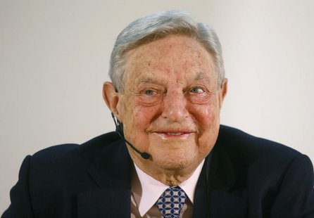 George Soros, Chairman of Soros Fund Management LLC smiles as he addresses the audience during an economic speech in Frankfurt April 9, 2013
