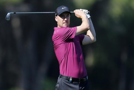 Ross Fisher of Britain plays a shot on the sixth hole during the third round of the inaugural Turkish Airlines Open in the southwest city of