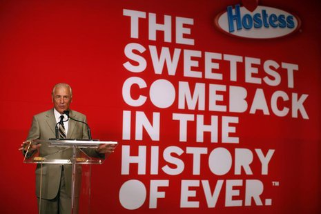"CEO of Hostess Brands Dean Metropoulos speaks at a ceremony marking the return of ""Twinkies"" at a plant in Schiller Park, Illinois, July 15,"