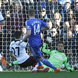 Chelsea's Andre Schurrle (C) scores a goal past Fulham's goalkeeper Maarten Stekelenburg (R) during their English Premier League soccer matc