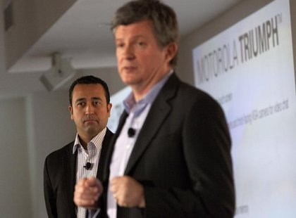 Product Chief at Sprint, Fared Adib (L) watches on as Motorola Senior Vice President of Product Development, Alain Mutricy speaks at the lau