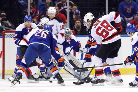 Mar 1, 2014; Uniondale, NY, USA; New Jersey Devils right wing Jaromir Jagr (68) scores a goal against New York Islanders goalie Evgeni Nabok
