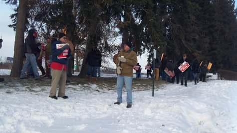 About three dozen protesters were on hand in the bitter cold to greet the republicans as they arrived for last night's event.