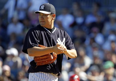 Mar 1, 2014; Tampa, FL, USA; New York Yankees pitcher Masahiro Tanaka (19) looks on during the sixth inning against the Philadelphia Phillie