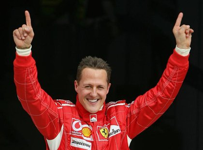 Ferrari Formula One driver Michael Schumacher of Germany celebrates after taking the pole position at the end of the qualifying session for