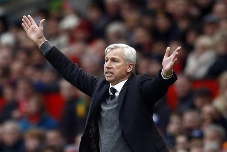 Newcastle United manager Alan Pardew reacts during their English Premier League soccer match against Manchester United at Old Trafford in Ma