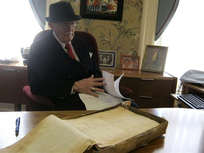 Dudley Martin looks at handwritten manuscripts written by Robert Stroud at his home in Springfield, Missouri, February 12, 2014. REUTERS/Kev