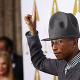 Rapper Pharrell Williams arrives at the 86th Academy Awards nominees luncheon in Beverly Hills, California February 10, 2014. REUTERS/Mario