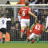 Tottenham Hotspur's Roberto Soldado (L) scores against Cardiff City during their English Premier League soccer match at White Hart Lane in L