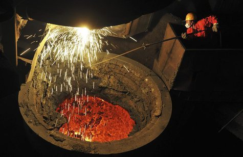 An employee works above a furnace containing molten steel at a factory of Dongbei Special Steel Group Co. Ltd. in Dalian, Liaoning province
