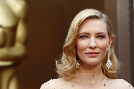 "Cate Blanchett, best actress nominee for her role in ""Blue Jasmine"" wears a nude Armani gown with metallic embellishments as she poses at th"