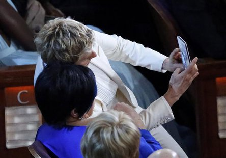 "Host Ellen DeGeneres (top) takes a ""selfie"" photo with actress and singer Liza Minnelli at the 86th Academy Awards in Hollywood, California"