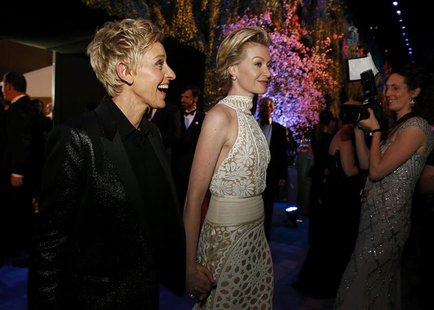 Academy Awards host Ellen Degeneres and her partner Portia de Rossi at the Governors Ball after the 86th Academy Awards in Hollywood, Califo