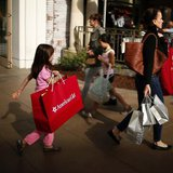 People shop at The Grove mall in Los Angeles November 26, 2013. REUTERS/Lucy Nicholson