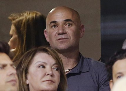 Former professional tennis player Andre Agassi attends the men's singles quarterfinal match between Rafael Nadal of Spain and Roger Federer