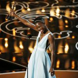 "Lupita Nyong'o, best supporting actress winner for her role in ""12 Years a Slave"", speaks on stage at the 86th Academy Awards in Hollywood,"