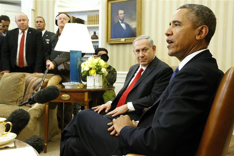 Israel's Prime Minister Benjamin Netanyahu (2nd R) listens to remarks by U.S. President Barack Obama (R) as they sit down to meet in the Ova