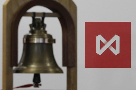 The bell rung at the beginning of trading sessions is seen in front of the logo of the Moscow Exchange after the start of trading in Moscow