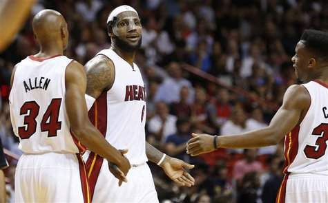 Mar 3, 2014; Miami, FL, USA; Miami Heat small forward LeBron James (6) is congratulated by Miami Heat shooting guard Ray Allen (34) and Miam