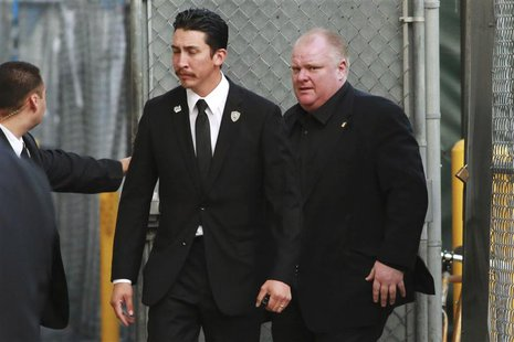 "Embattled Toronto Mayor Rob Ford (R) arrives for an appearance on the ""Jimmy Kimmel Live!"" show in Hollywood, California March 3, 2014. REUT"