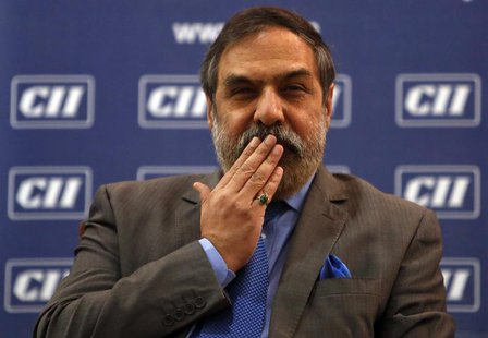 India's Trade Minister Anand Sharma gestures as he speaks with the media after interacting with students at a college in Mumbai February 11,