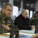 Russia's President Vladimir Putin (C), Defence Minister Sergei Shoigu (L) and head of the Russian army's main department of combat preparati