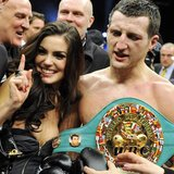 "Britain's Carl ""The Cobra"" Froch holding the WBC super middleweights belt celebrates with wife Rachael Coardingly after defeating Germany's"