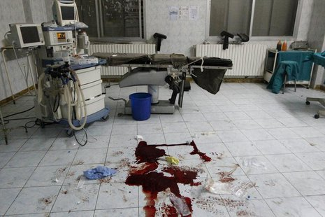 Blood is seen on a hospital floor in what activists say was shelling from forces loyal to President Bashar Al-Assad in Raqqa, eastern Syria
