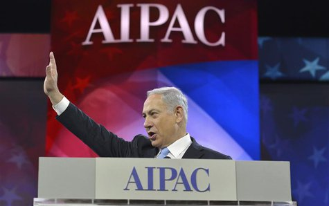 Israeli Prime Minister Benjamin Netanyahu acknowledges applause as he arrives to address the American Israel Public Affairs Committee (AIPAC