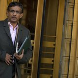 Conservative commentator and best-selling author, Dinesh D'Souza exits the Manhattan Federal Courthouse in New York, January 24, 2014. REUTE