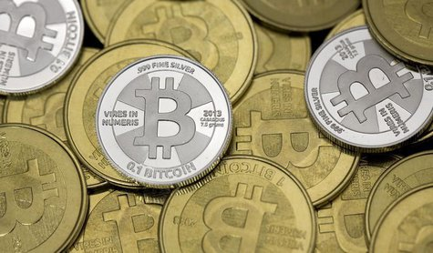 Some of Bitcoin enthusiast Mike Caldwell's coins are pictured at his office in this photo illustration in Sandy, Utah, January 31, 2014. REU