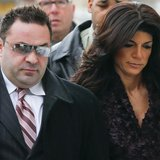 "Teresa Giudice, 41, (R) and her husband Giuseppe ""Joe"" Giudice, 43, (L) arrive at the Federal Court in Newark, New Jersey, March 4, 2014. RE"