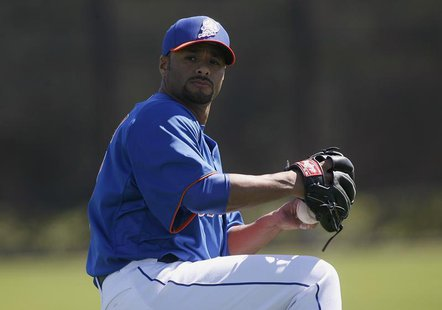 New York Mets pitcher Johan Santana throws during a MLB National League baseball spring training workout in Port St Lucie, Florida February