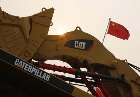 A Caterpillar excavator is displayed at the China Coal and Mining Expo 2013 in Beijing October 22, 2013. Picture taken October 22, 2013. REU
