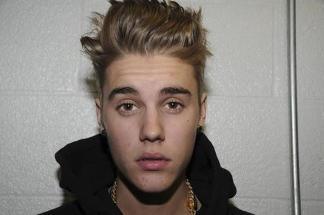 Canadian pop singer Justin Bieber is pictured in police custody in Miami Beach, Florida February 12, 2014 in this Miami Beach Police Departm
