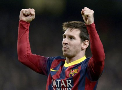 Barcelona's Lionel Messi celebrates after scoring a penalty against Manchester City during their Champions League round of 16 first leg socc